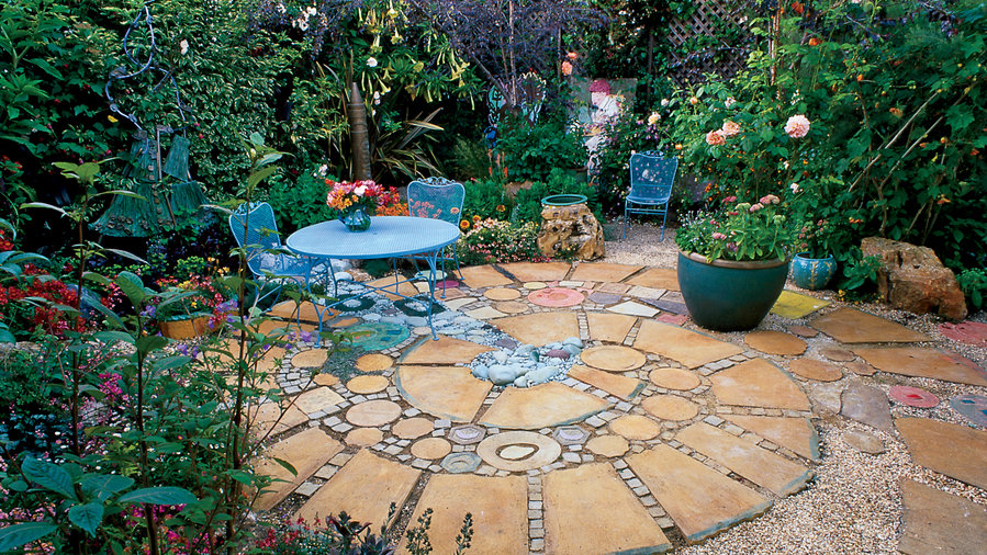 Colored stones, surrounded by pavers of stained concrete, create the illusion of a stream