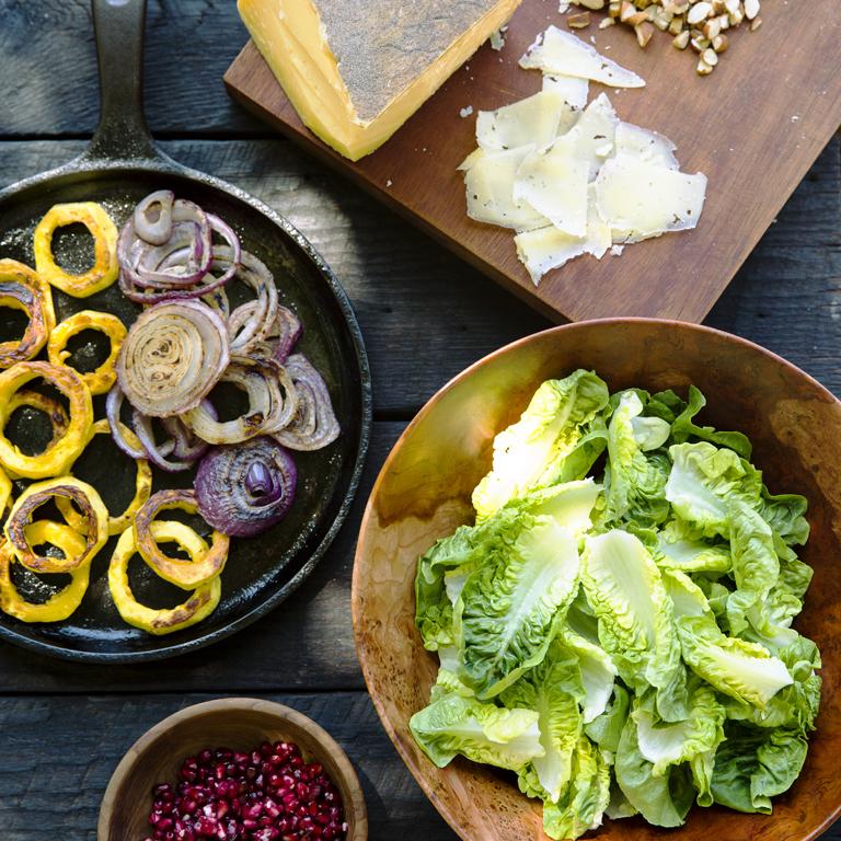 su-Green Salad with Almonds, Charred Onion, and Pomegranates Image