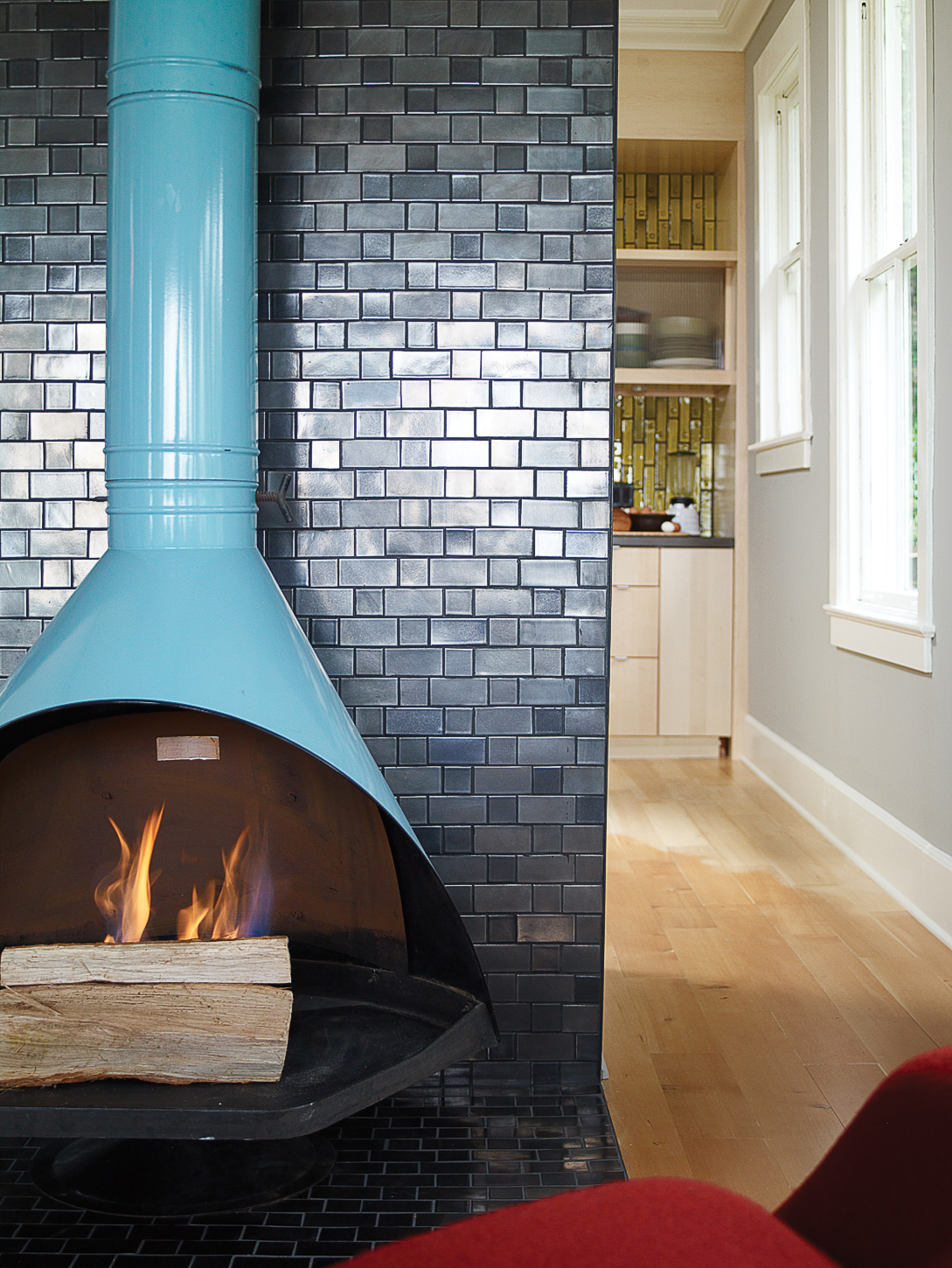 11 chic ideas for fireplaces sunset magazine let it stand out the dark ceramic tiles dailygadgetfo Choice Image