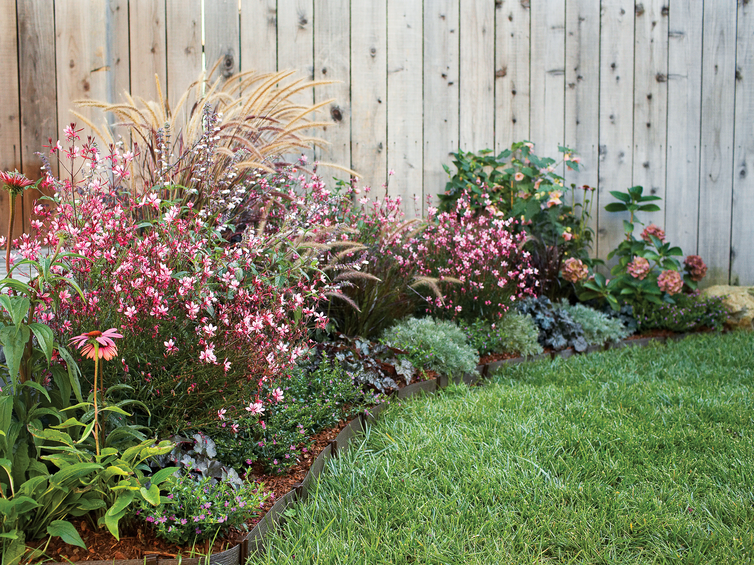 Flowers Garden Ideas: See How To Use Foliage And Flowers To Soften A Wall