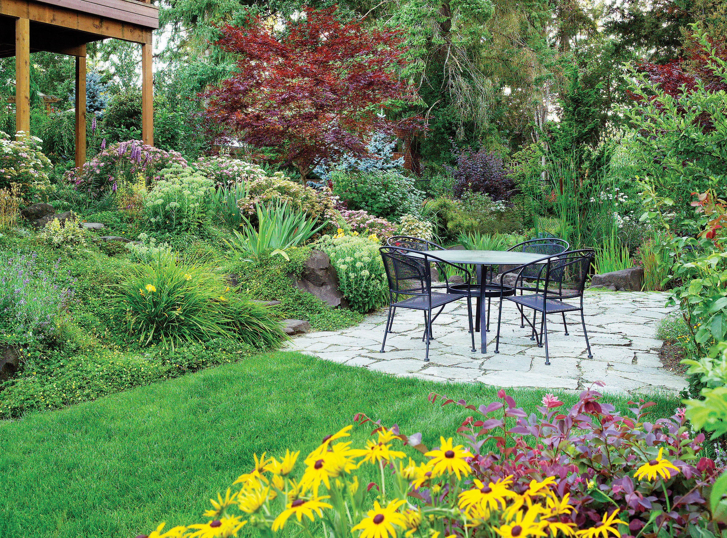 Terraces and plants make the most of a downhill garden for Great landscaping ideas backyard