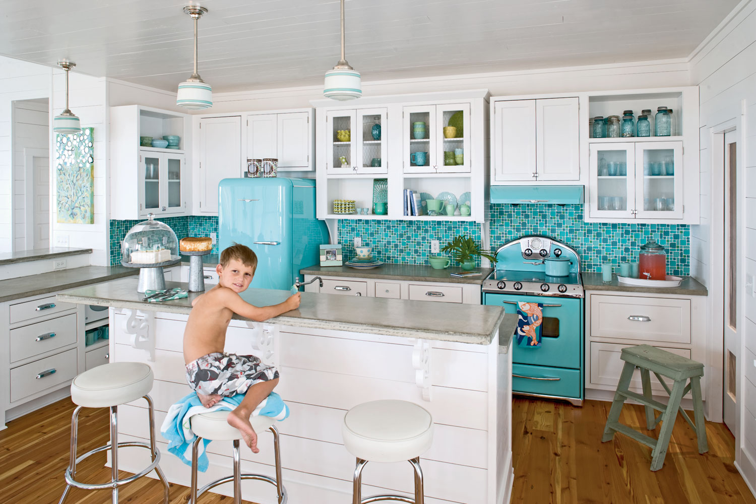 In these kitchens, color makes a tastefully cheerful statement ...