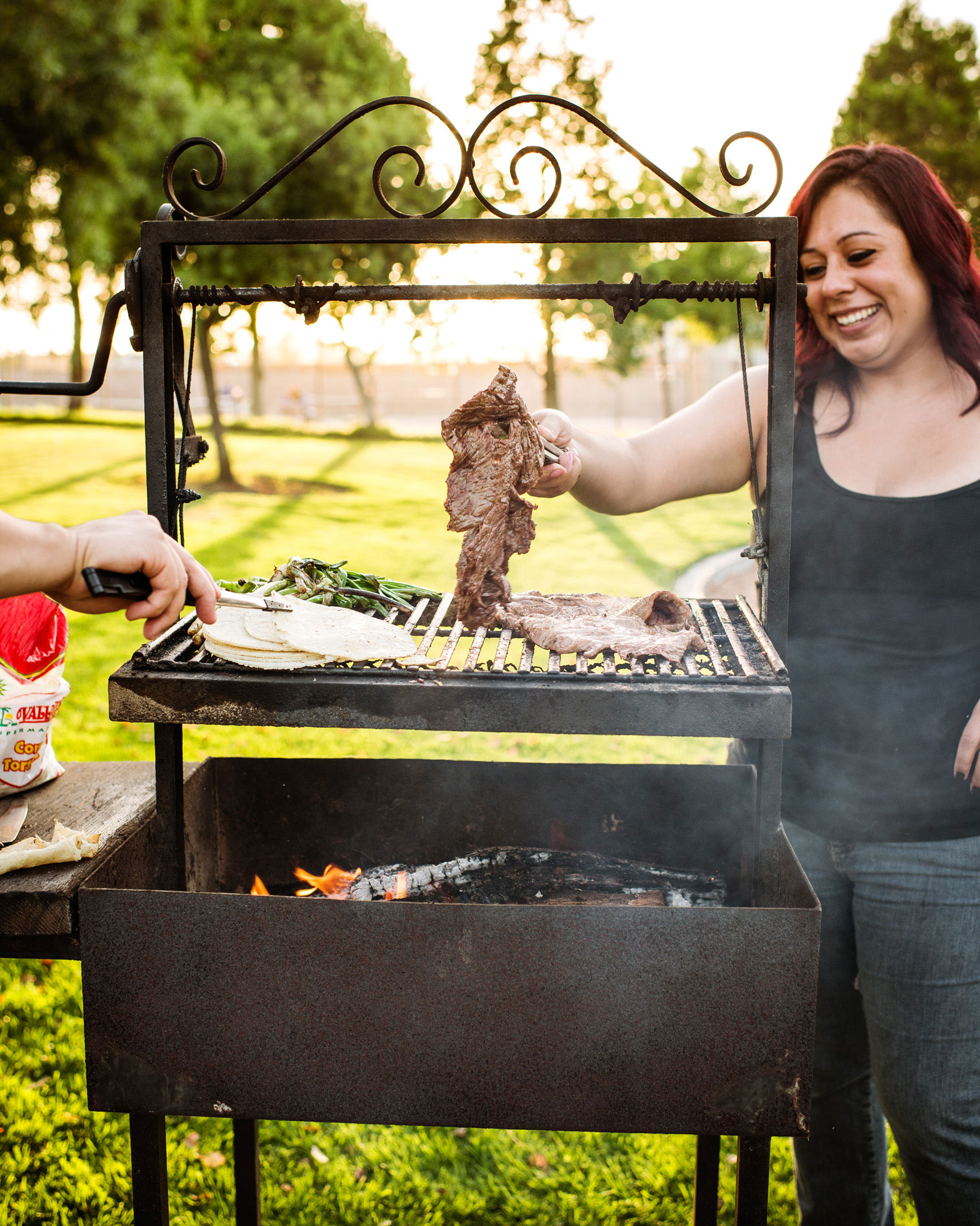 stephanie correa grills a flap steak in the park in santa maria
