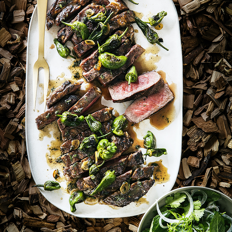su-Grilled Rib-Eye Steaks with Blistered Padrón Peppers Image