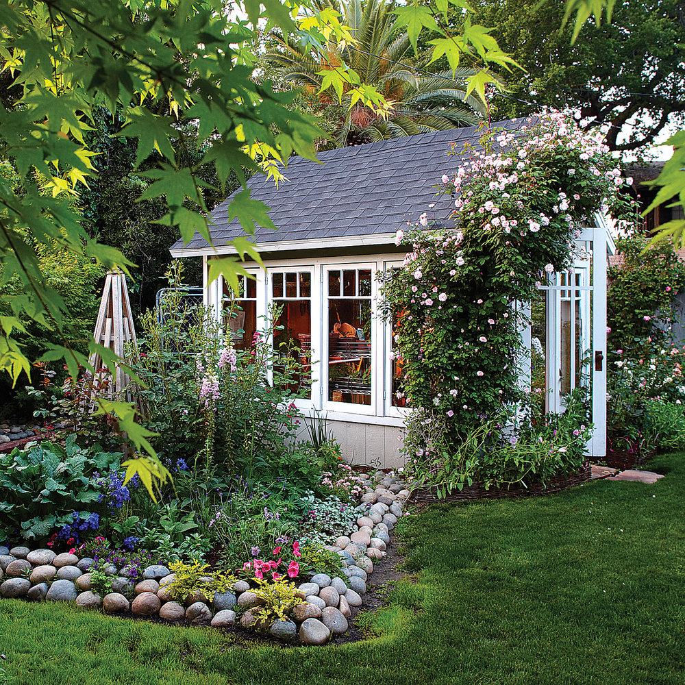 bright and airy  this backyard shed and greenhouse is a