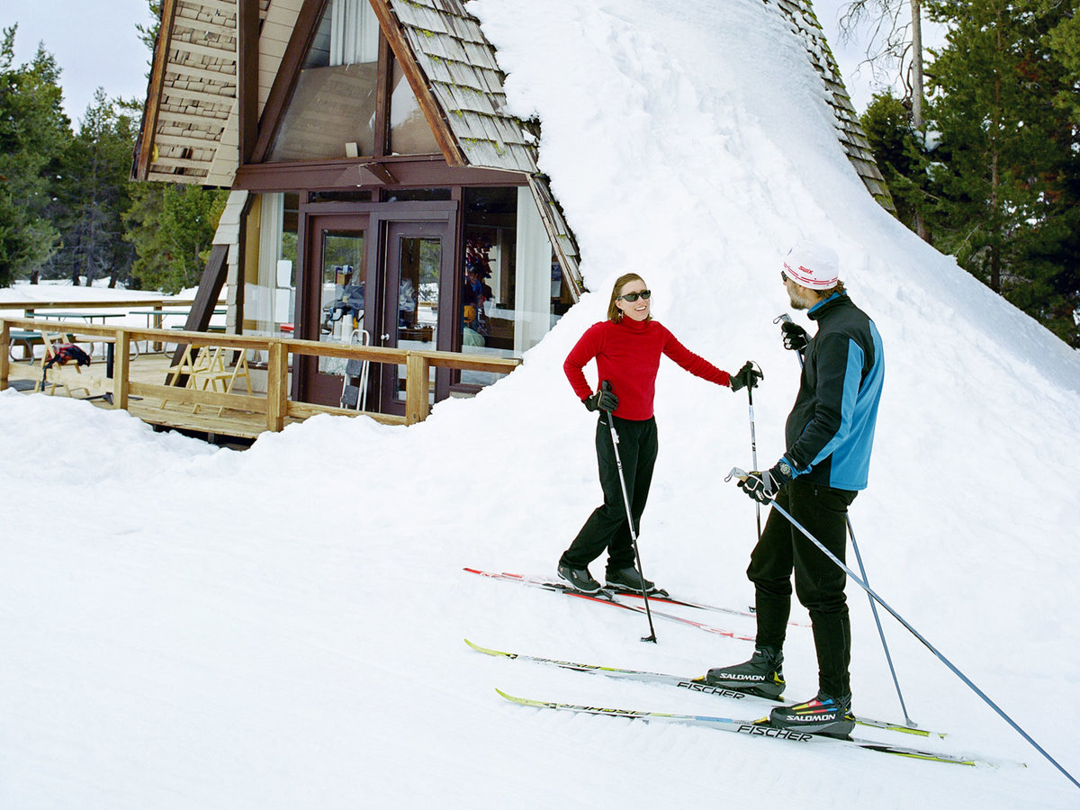 Skiers stand near a warming hut at Bear Valley's cross-country resort.
