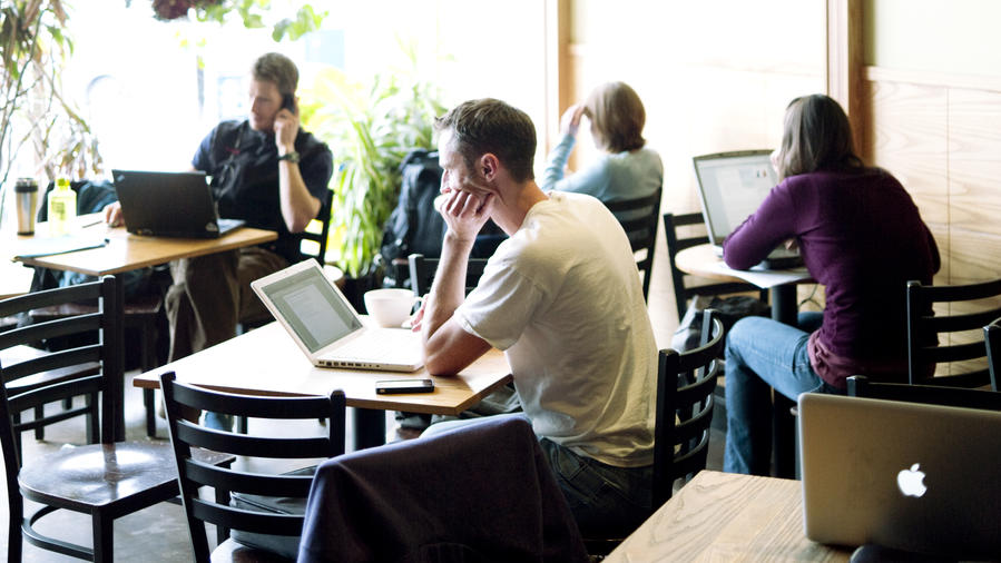 Entrepreneurs in a sunny coffee shop in one of the best places to live in Salt Lake City, Utah