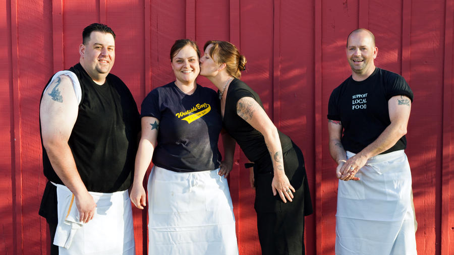 Chefs posing together in front of red building at Fig & The Girl in Sonoma, one of the best places to live