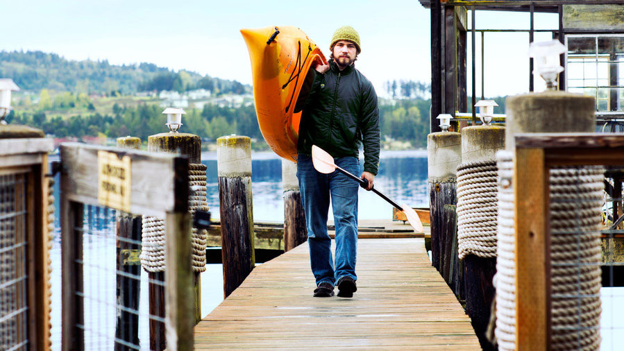 beach towns on the West Coast, Sequim, WA guy walking with kayak on dock