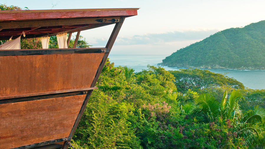 Unusual hotel rooms perfect above the sea and forest in Yalapa, Mexico