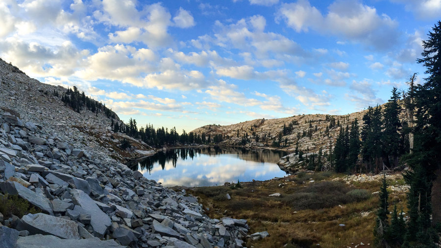 Hiking views on an alpine lake and rocky mountain in California's Desolation Wilderness