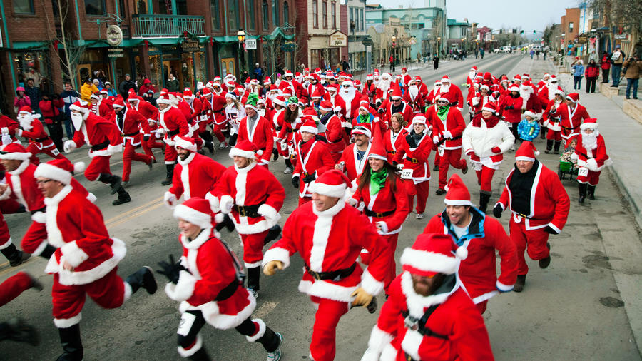 Santas running down the street in Breckenridge