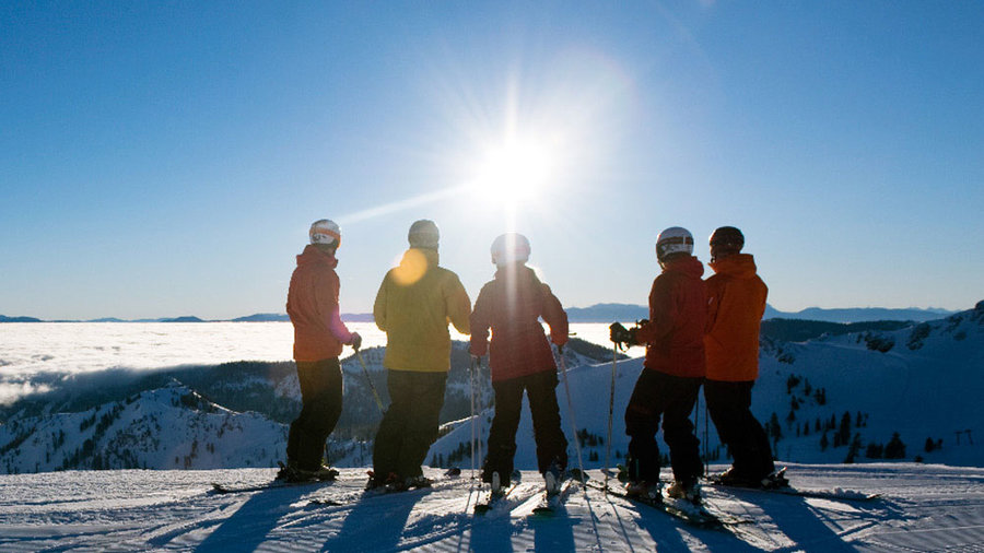 Skiers stand around talking at Squaw Valley