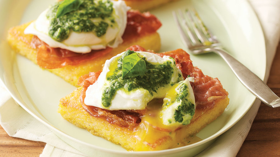<em>Uova Benedetto</em> (Poached Eggs on Polenta with Pesto and Crisp Prosciutto)