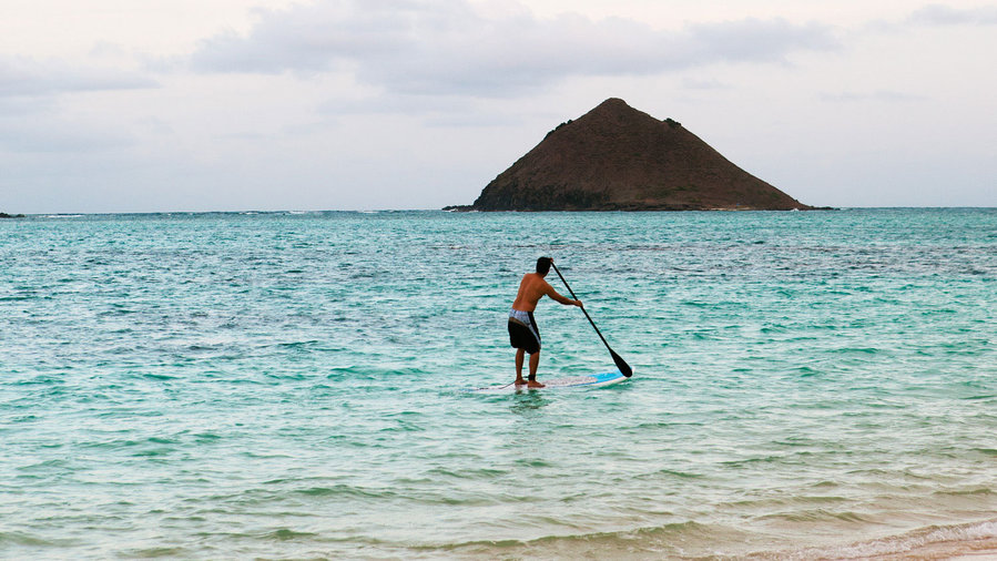 Stand up paddle boarding in the ocean in Koolaupoko Hawaii