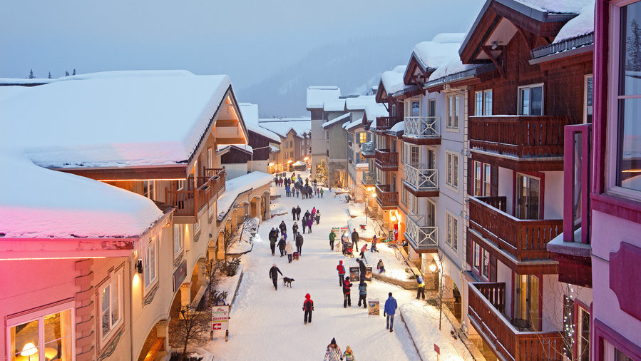 The quaint village at Sun Peaks in B.C. at dusk, covered in snow