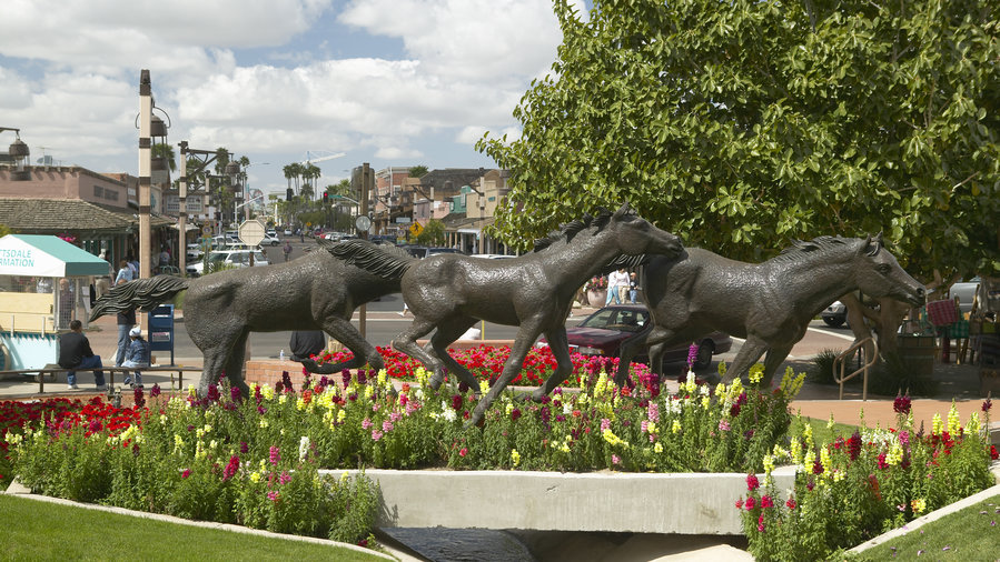 Bronze horse sculpture with spring flowers in Old Town Scottsdale, Arizona