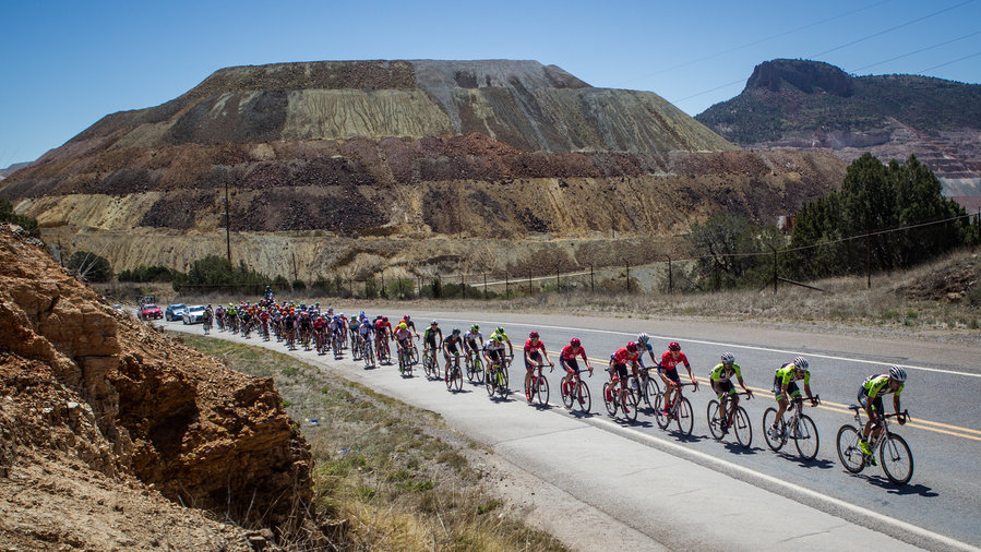 Cyclists pass by the Santa Rita Mine during the Tour of the Gila in Silver City, New Mexico