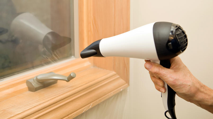 Sealing Leaky Windows with Plastic