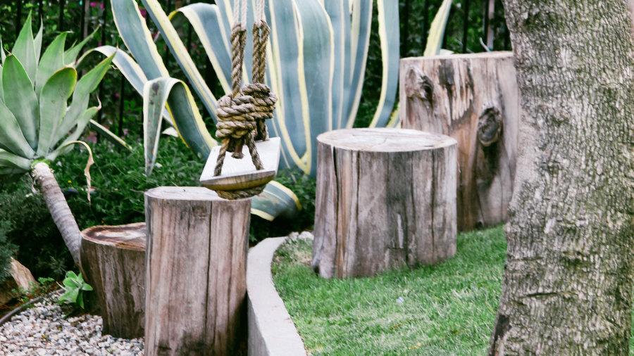 How to Design an Outdoor Play Yard - Sunset Magazine Garden Designs Around Stumps on moss garden designs, rock garden designs, wood garden designs, stone garden designs, spring garden designs, sun garden designs, lee garden designs, green garden designs, white garden designs, hill garden designs, shrub garden designs, king garden designs, rose garden designs, sand garden designs,