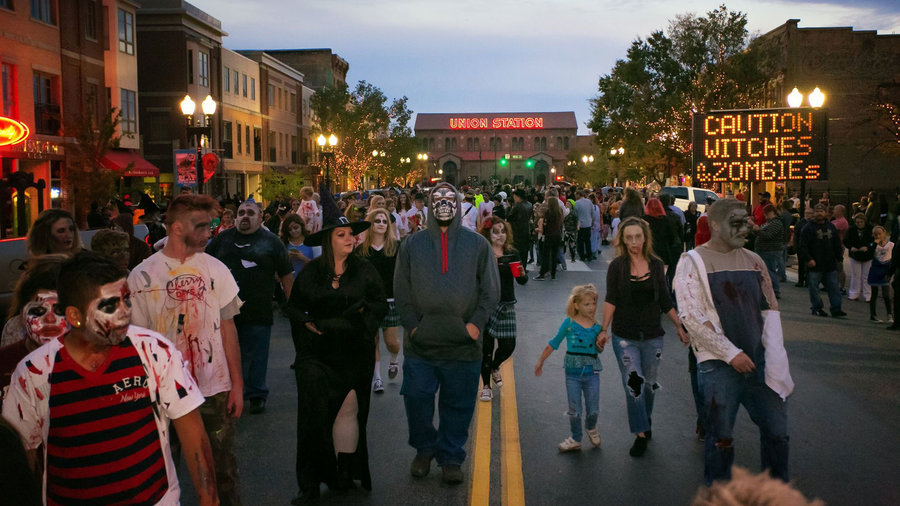 Witches, zombies, and monsters walking down the street at the Witchstock Festival, Halloween events in Ogden, UT