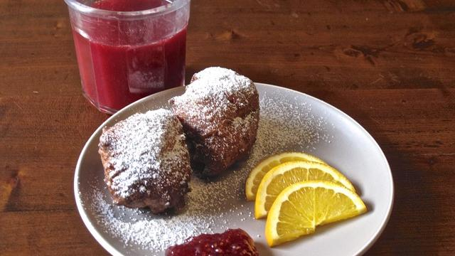 Suagar-dusted Lemon Ricotta Fritters with raspberry jam and freshly squeezed blood orange OJ.