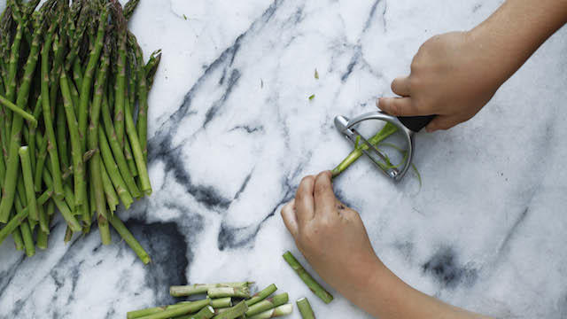 Peeling asparagus. Photo by Phyllis Grant