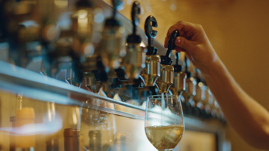 Bartender pouring wine from tap (Lisa Romerein/Getty)