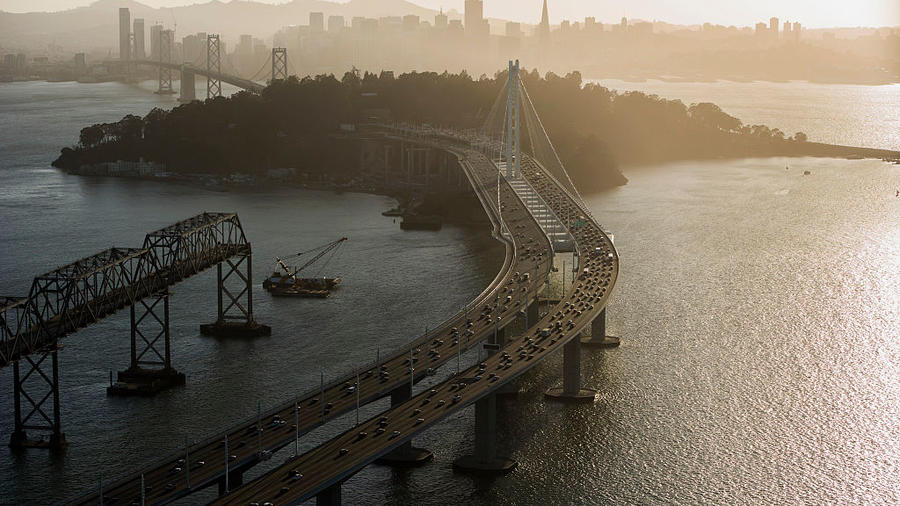 Cars travel over the San Francisco-Oakland Bay Bridge towards Treasure Island, 2015