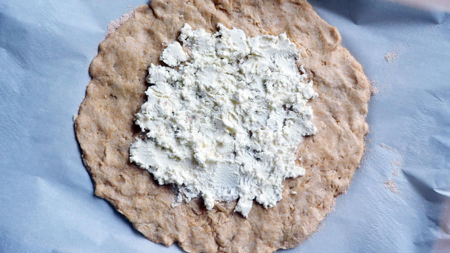 Dough slathered in goat cheese: the first clue that this just might be a tasty dish.