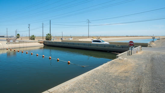 The Russell Avenue bridge, over the Delta Mendota Canal in Firebaugh, Calif., has subsided until there's almost no space between bottom of bridge decking and canal water surface, July 23, 2015.