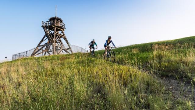 Trails like this one, next to Helena's landmark Fire Tower, helped the town win bronze status from the International Mountain Biking Association. (Audrey Hall / Sunset Publishing)