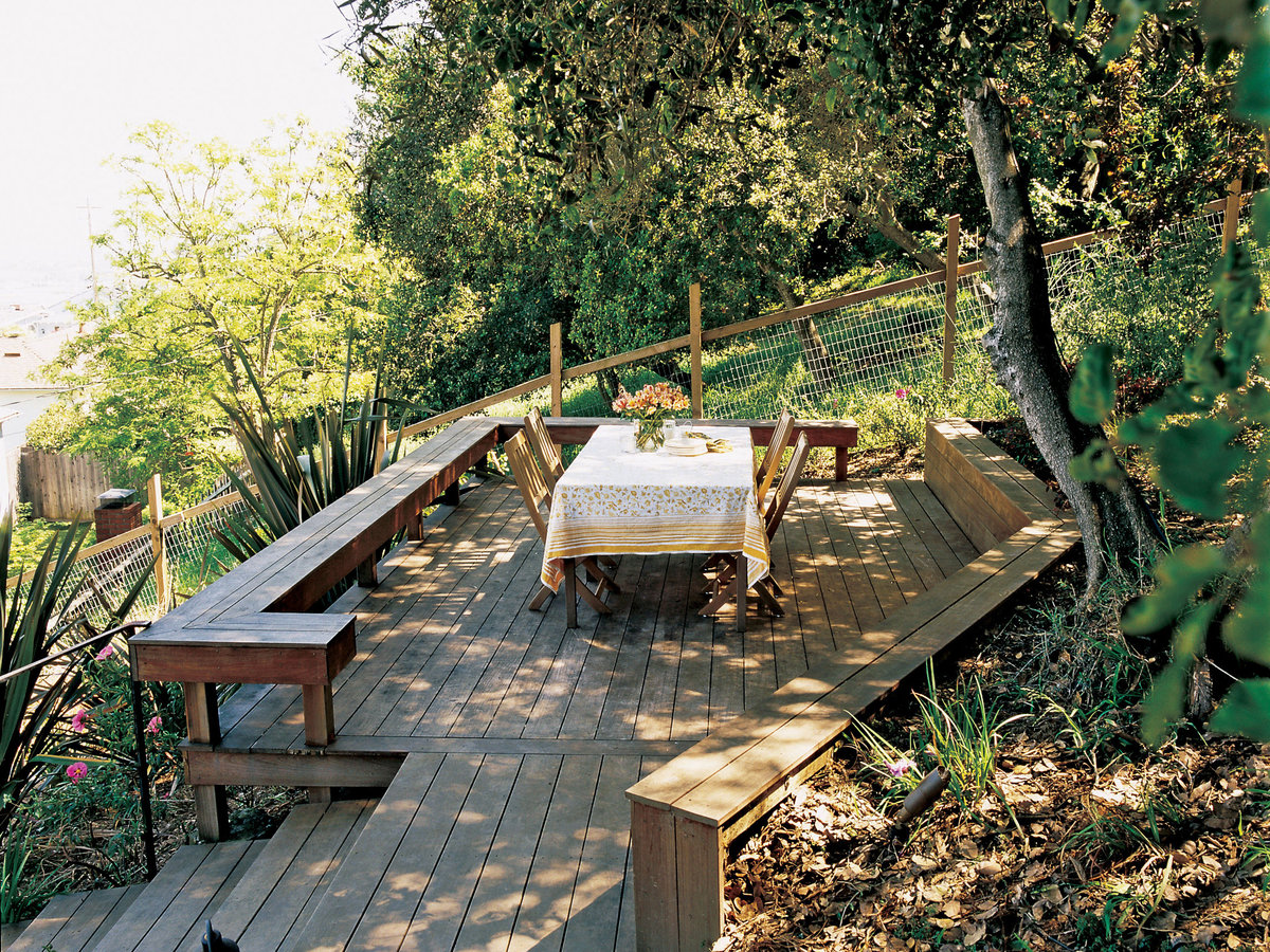 new deck and stairs tame a slope sunset magazine