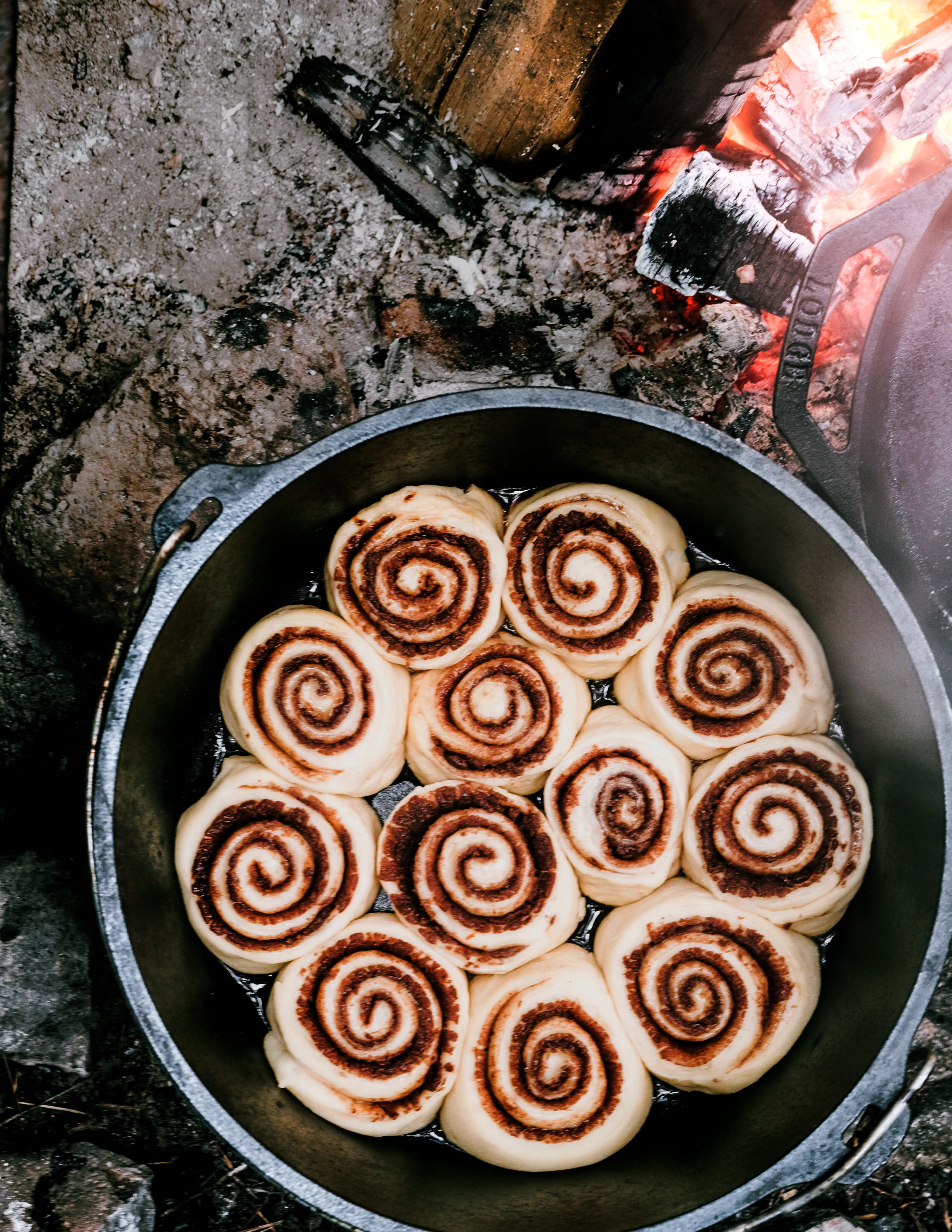 Dutch Oven Cinnamon Rolls with Orange Almond Icing